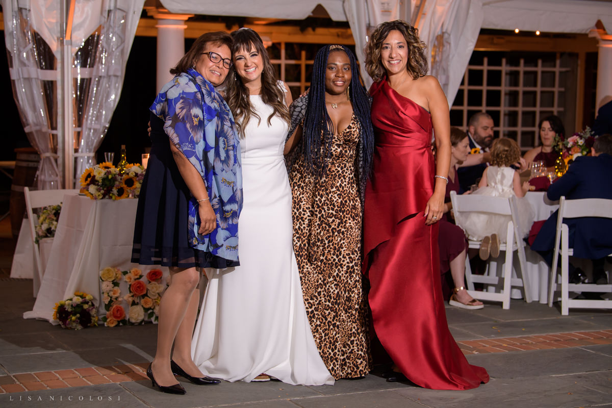 bride posing with her guests