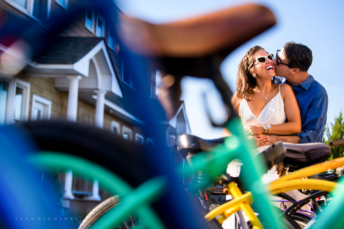 Fun engagement photos in Ocean Beach Village - Couple kissing near bicycles