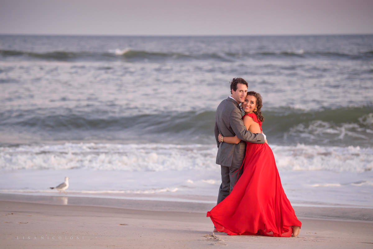 Fire Island Engagement Session - Ocean Beach - bride and groom to be hugging on beach