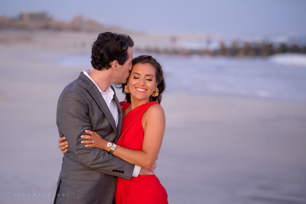 Fire Island Engagement Session - Ocean Beach - Couple hugging on beach at sunset