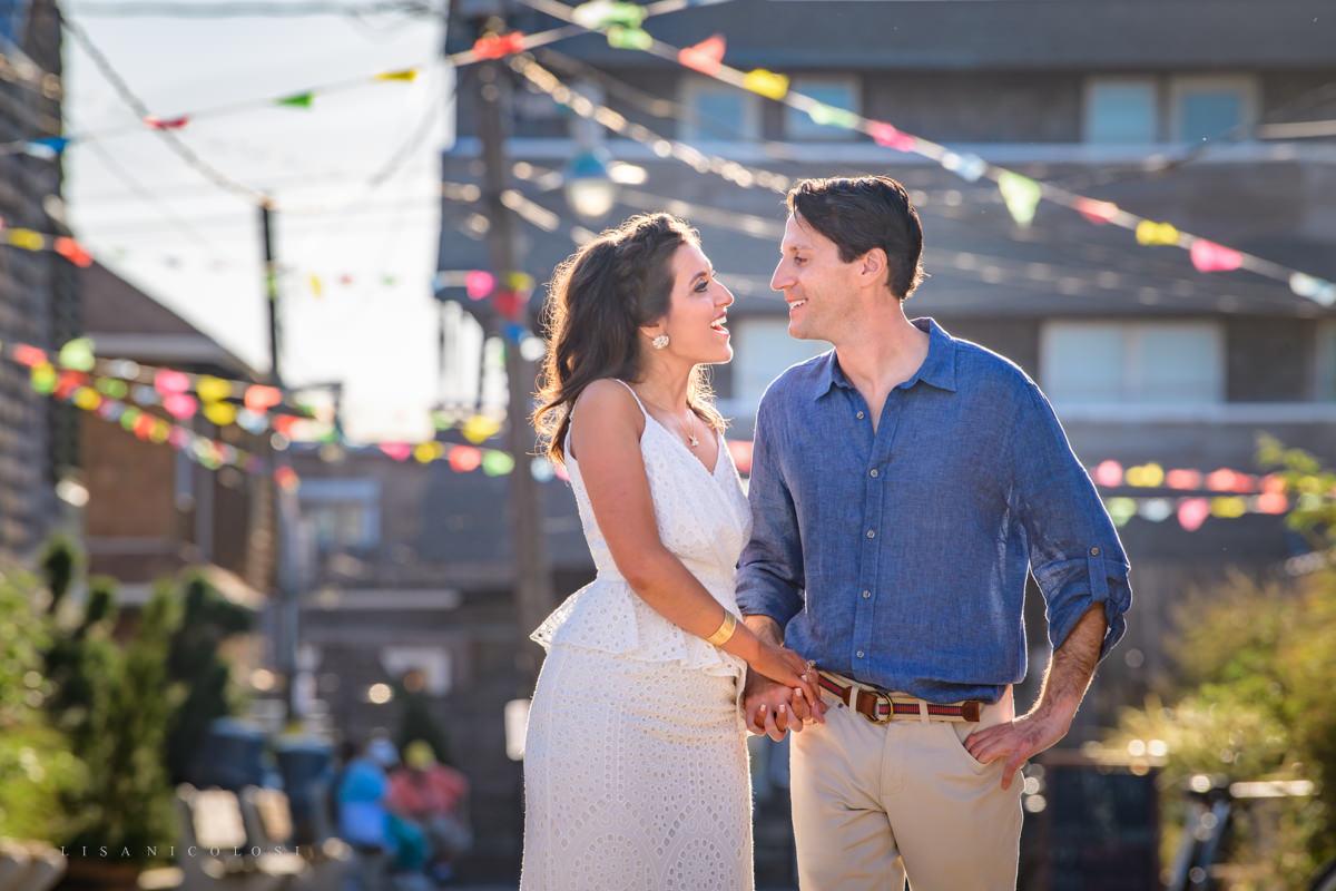 Fun engagement photos in Ocean Beach Village - Fire Island