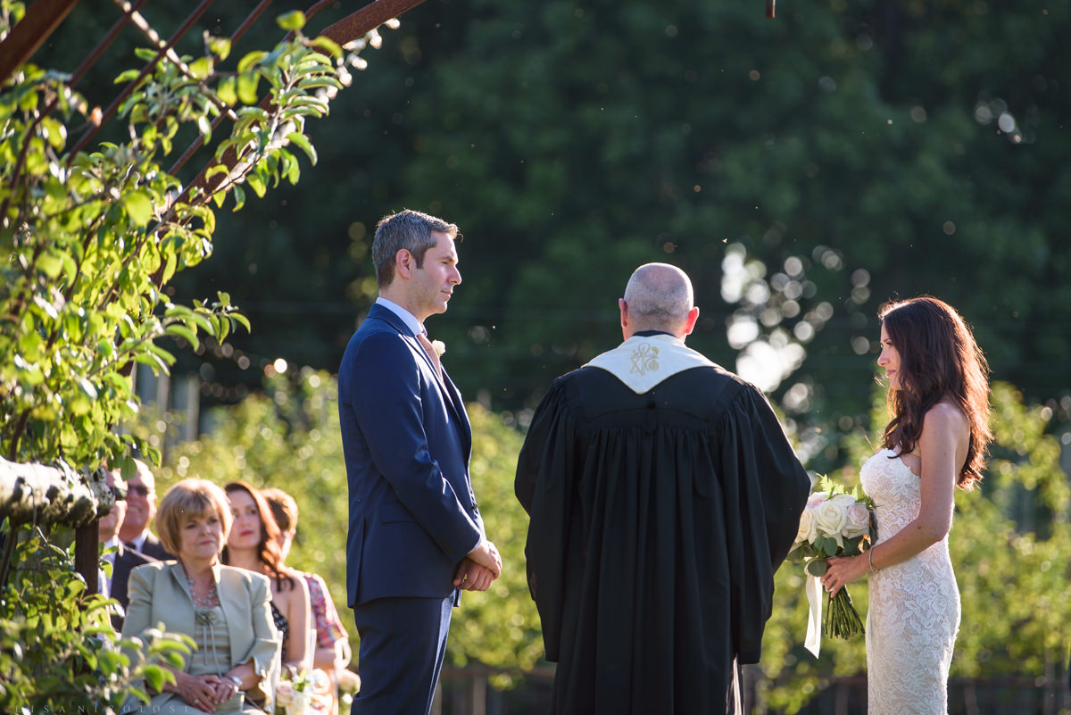 Jamesport Manor Inn Wedding Ceremony in the apple orchard