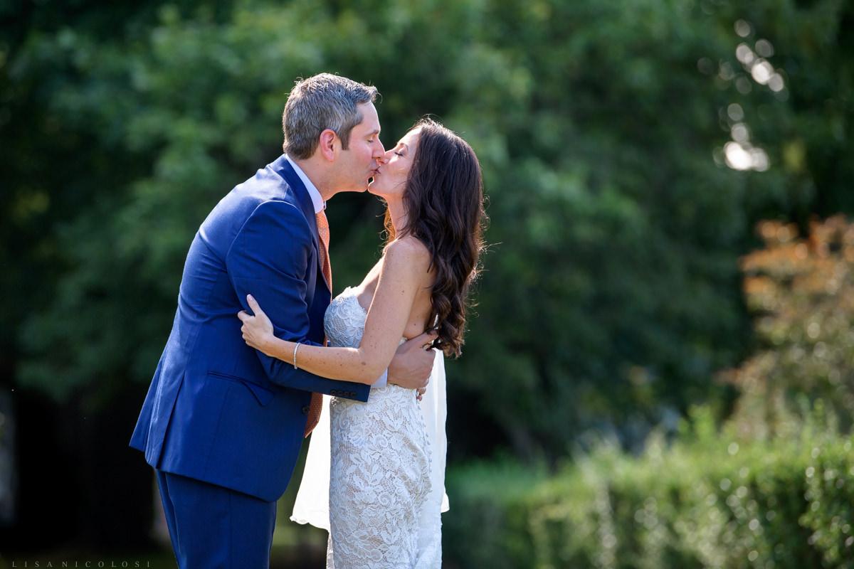 Jamesport Manor Inn Wedding - Bride and groom first look - kissing