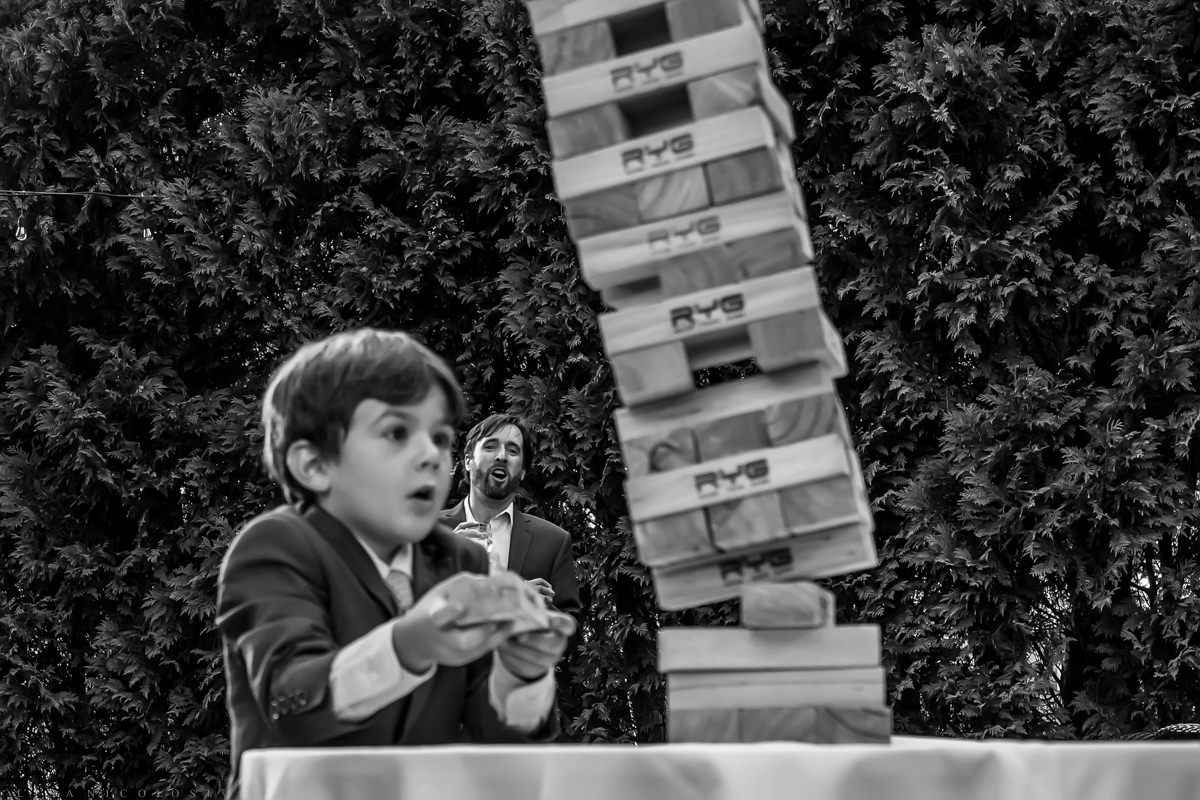 Jamesport Manor Inn Wedding - ring bearer playing Jenga
