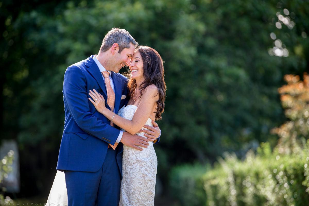 Jamesport Manor Inn Wedding - Bride and groom first look- hugging