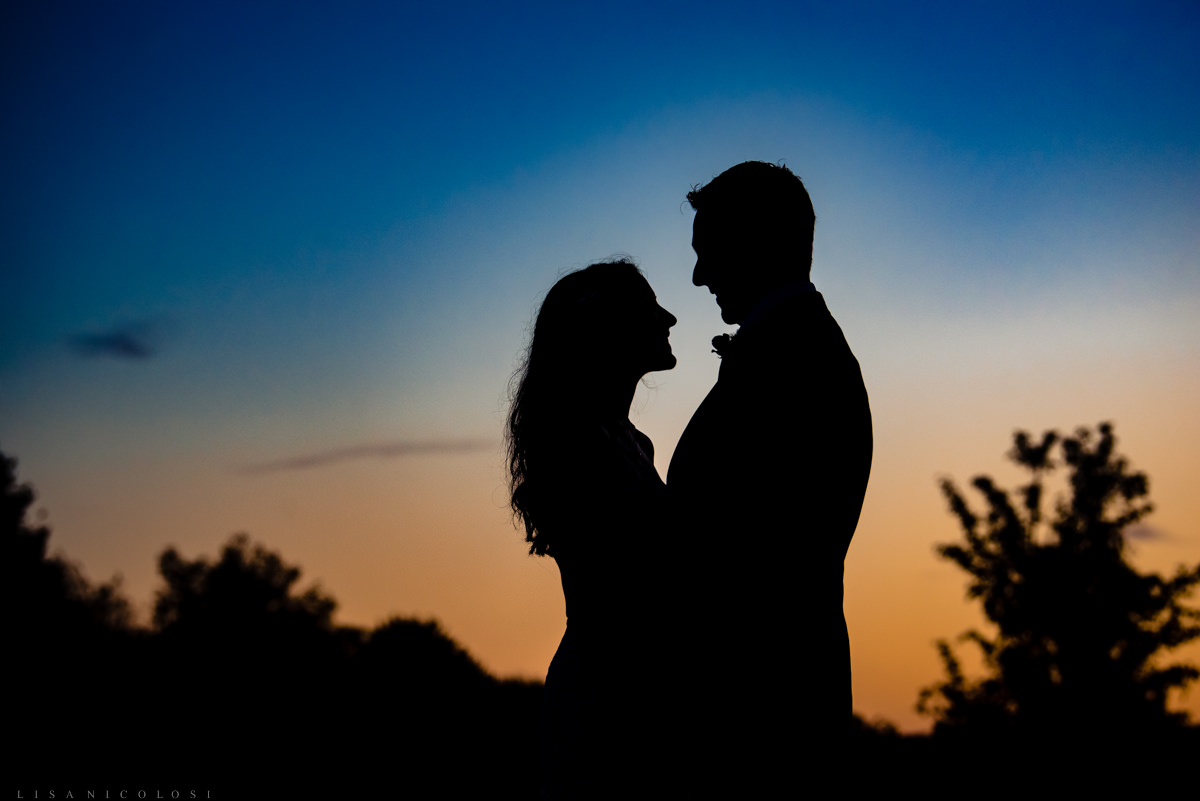 Sunset photo of bride and groom at Jamesport Manor Inn
