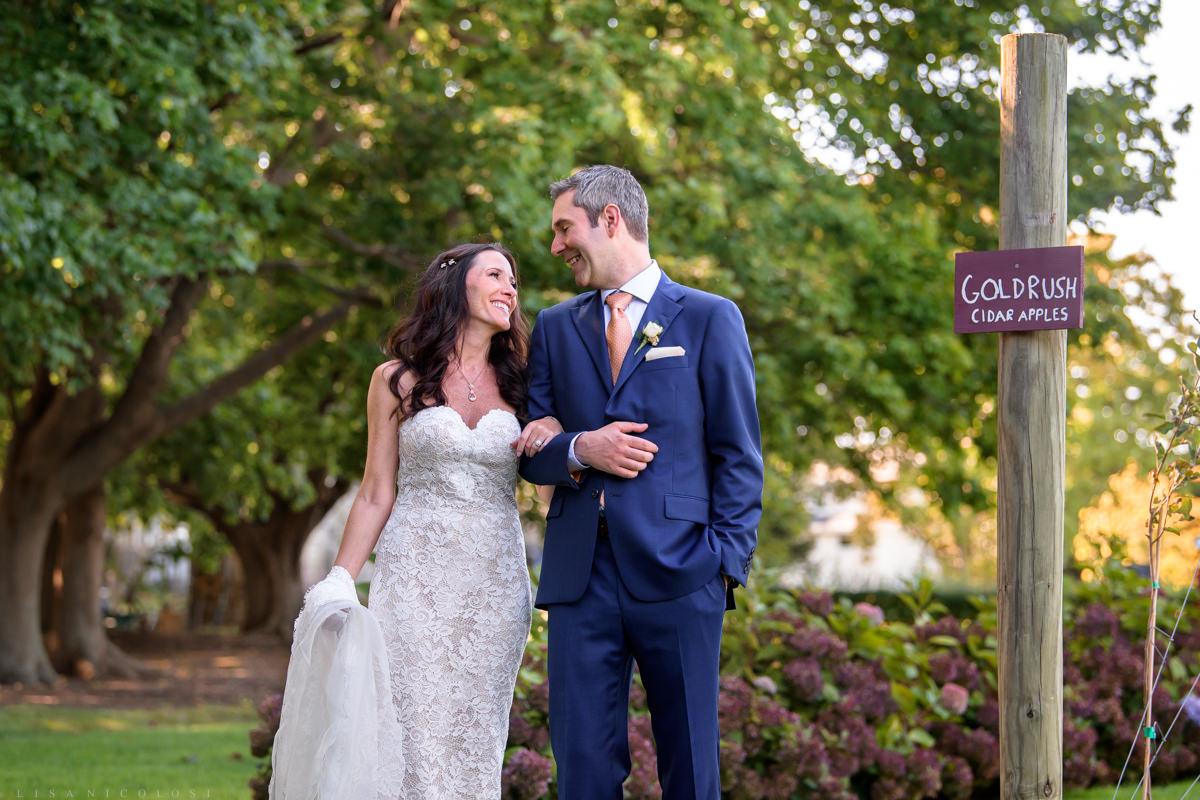 Jamesport Manor Inn Wedding - Bride and groom portraits in the apple orchard