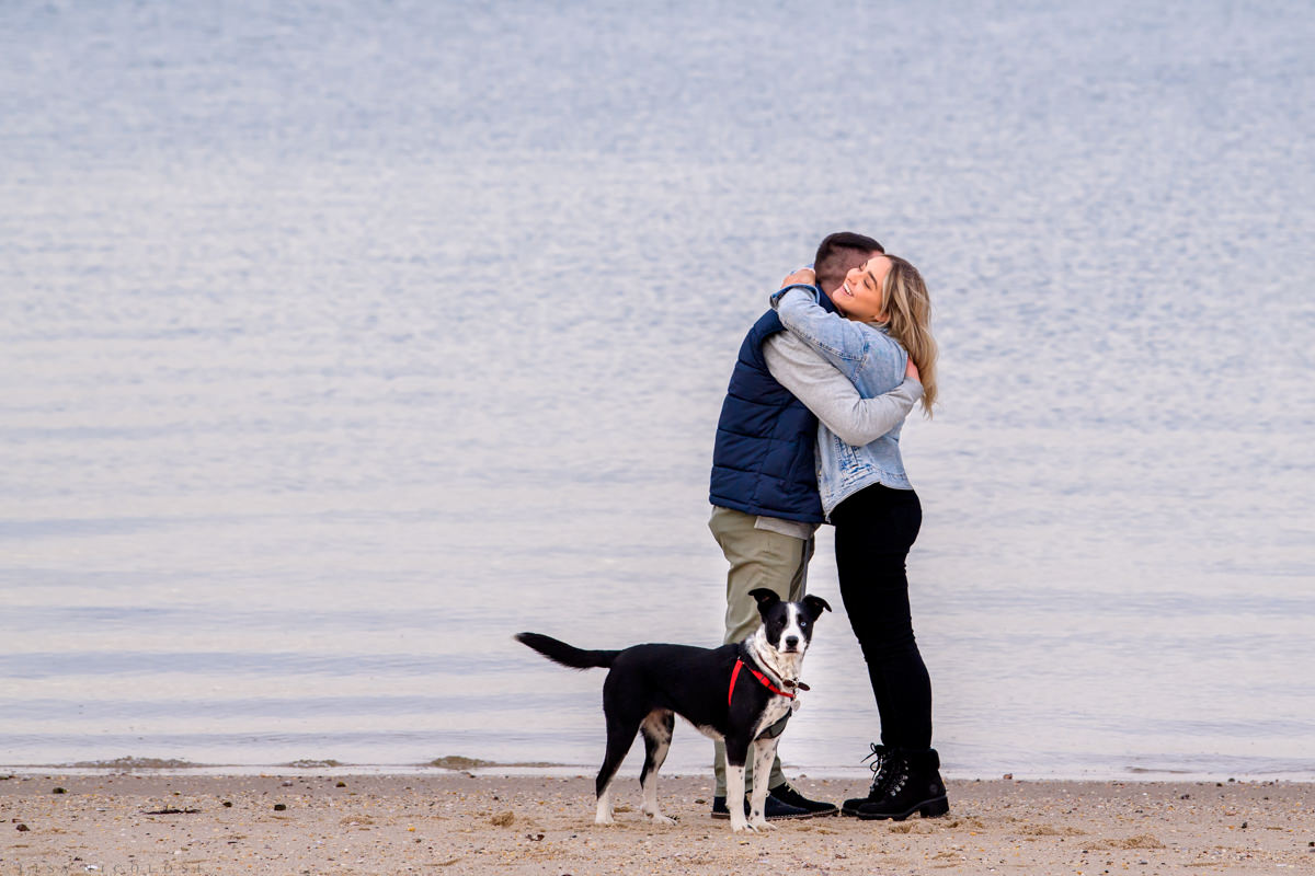 Hamptons surprise marriage proposal photo session on beach with couple's dog