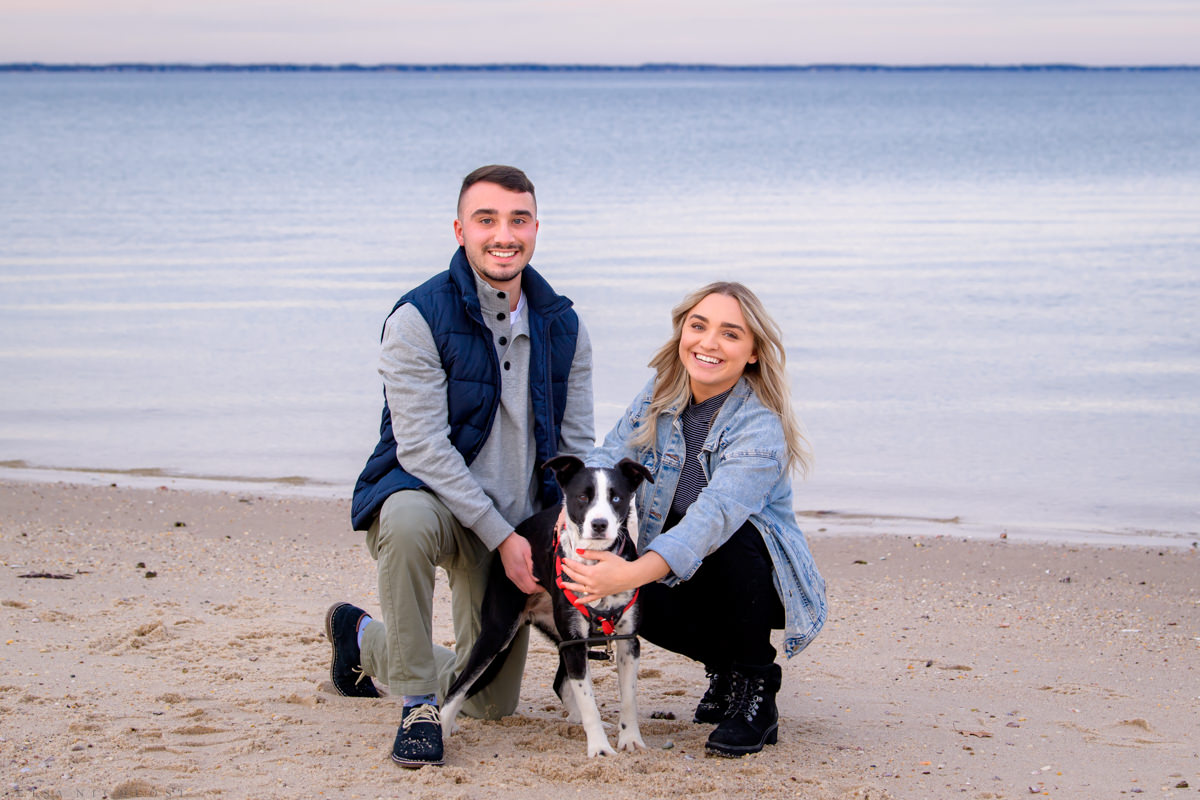 Engagement portrait on beach in Hampton Bays posing with their dog