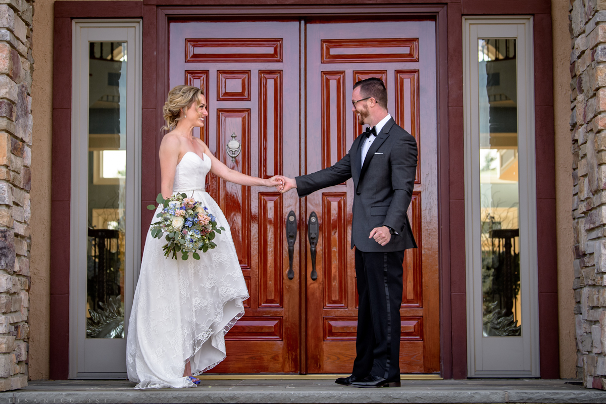 Bride and groom first look on porch of Royalton Equestrian Farms in Mattituck