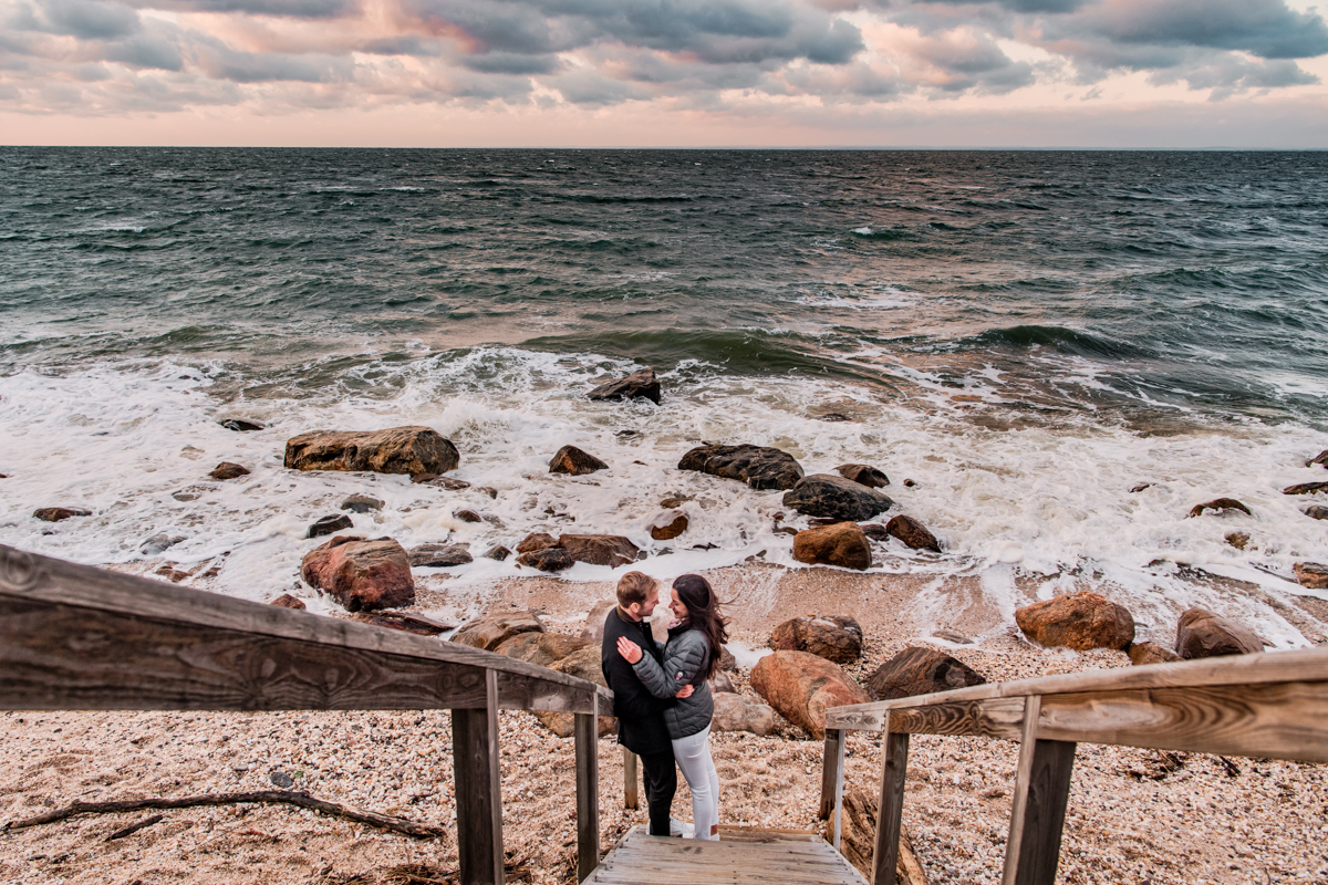 Greenport Proposal Photographer - Engagement photos on the 67 Steps Beach in Greenport