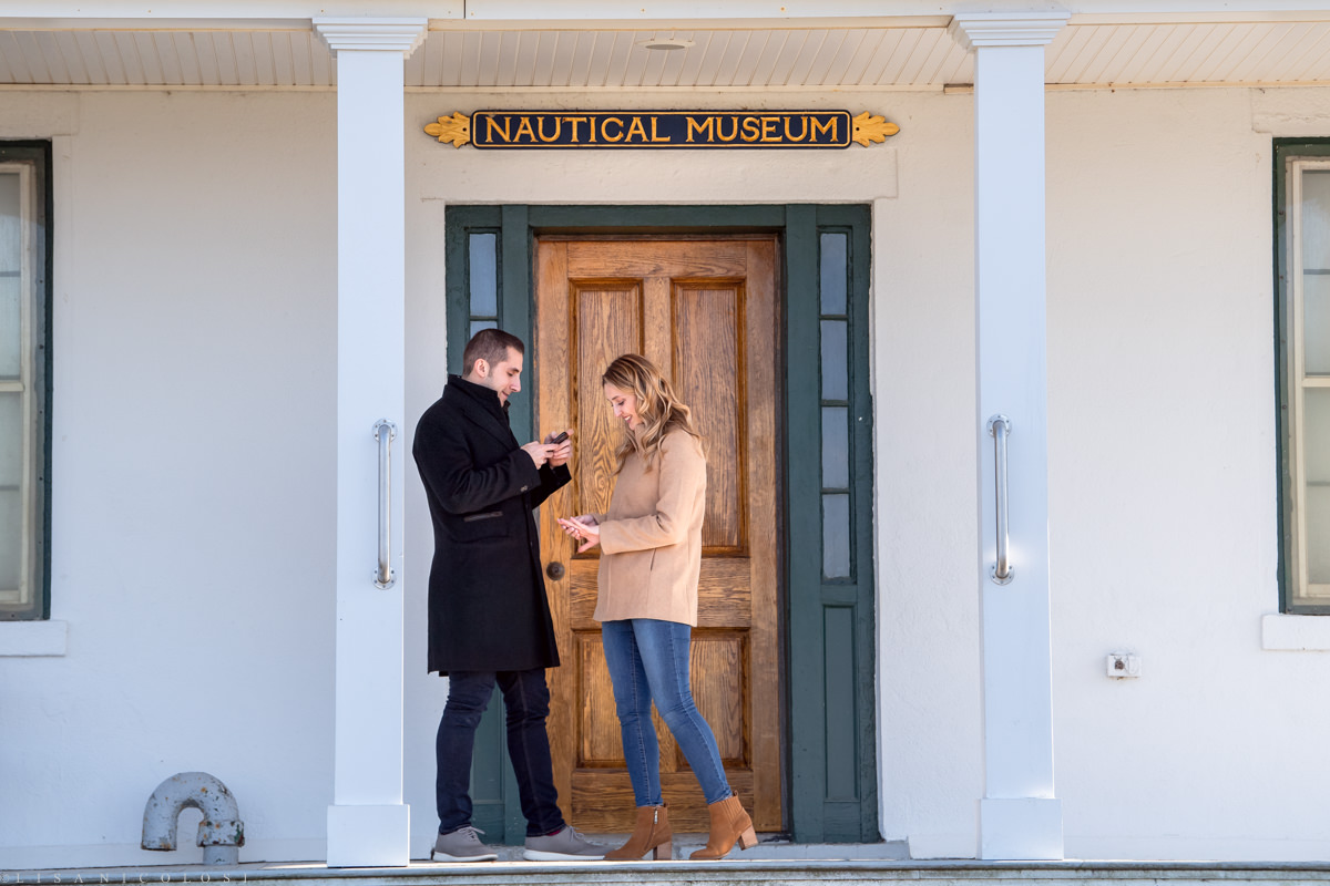 Bride to be admires her engagement ring on the porch - North Fork Marriage Proposal at Horton Point Lighthouse Nautical Museum