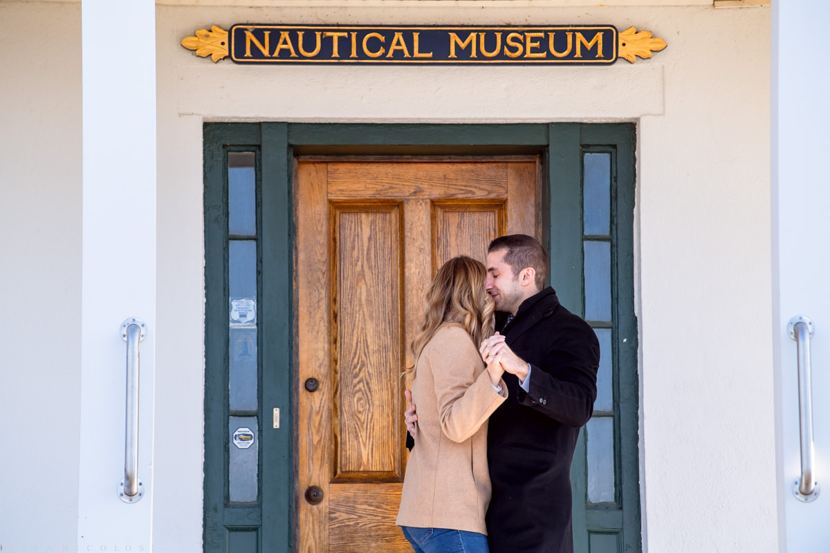 couple hugging during North Fork Marriage Proposal at Horton Point Lighthouse Nautical Museum