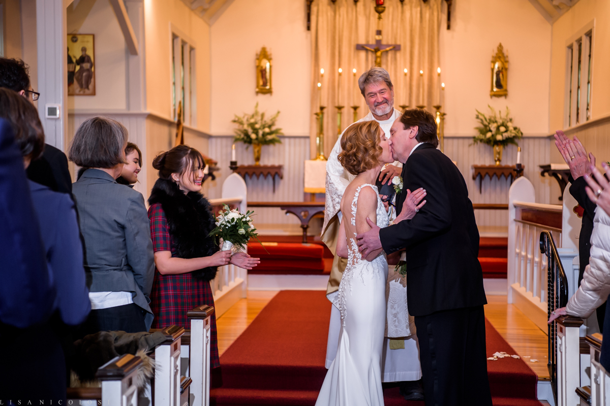 North Fork Wedding at Holy Trinity Episcopal Church - Bride and groom first kiss