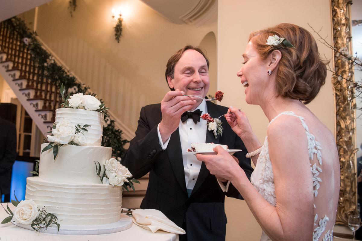 Fun Brecknock Hall wedding - Wedding reception - bride and groom cake cutting