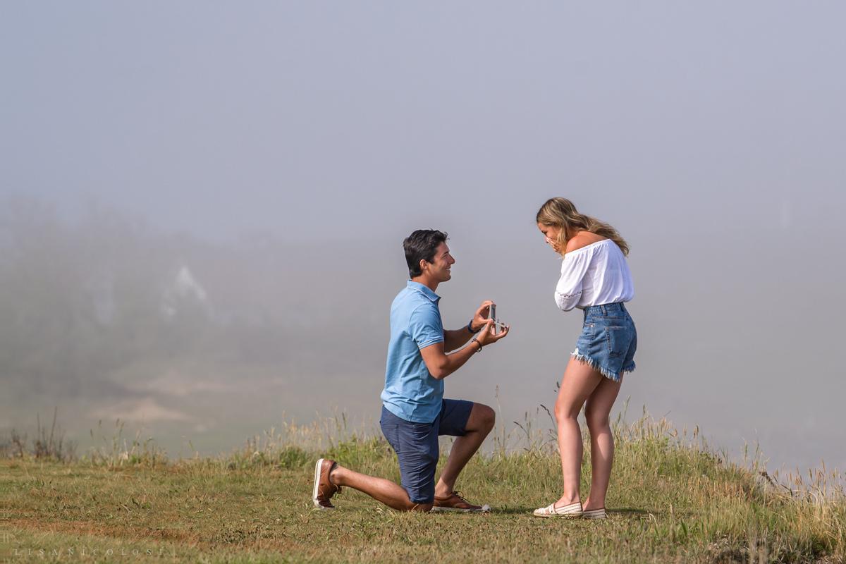 Groom kneeling to propose - Montauk Engagement