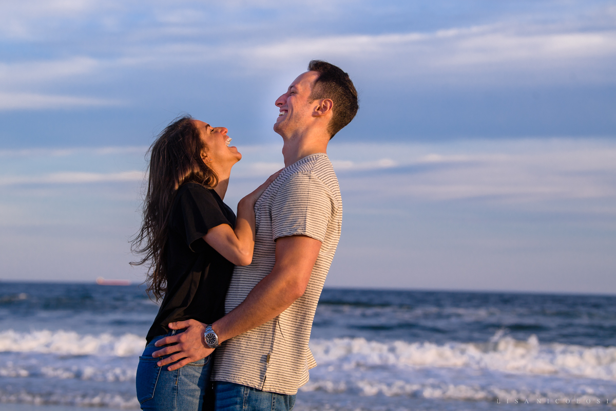 Engagement Photos of couple laughing at Atlantic Beach NY - Long Island Proposal Photographer