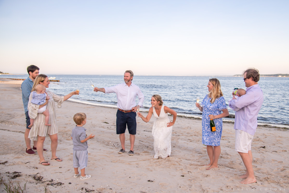 North Fork Micro Wedding on the beach - Bride and groom toasting champagne with guests