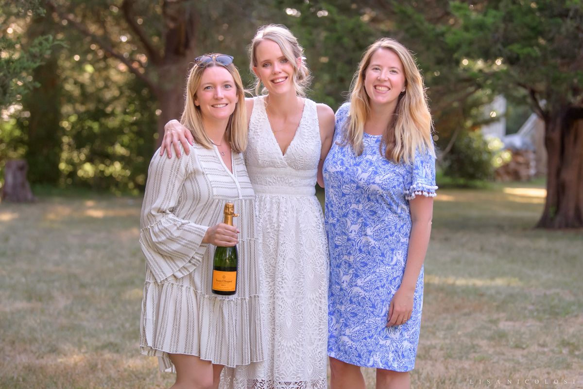 North Fork intimate backyard wedding in Jamesport - Bride with her friends