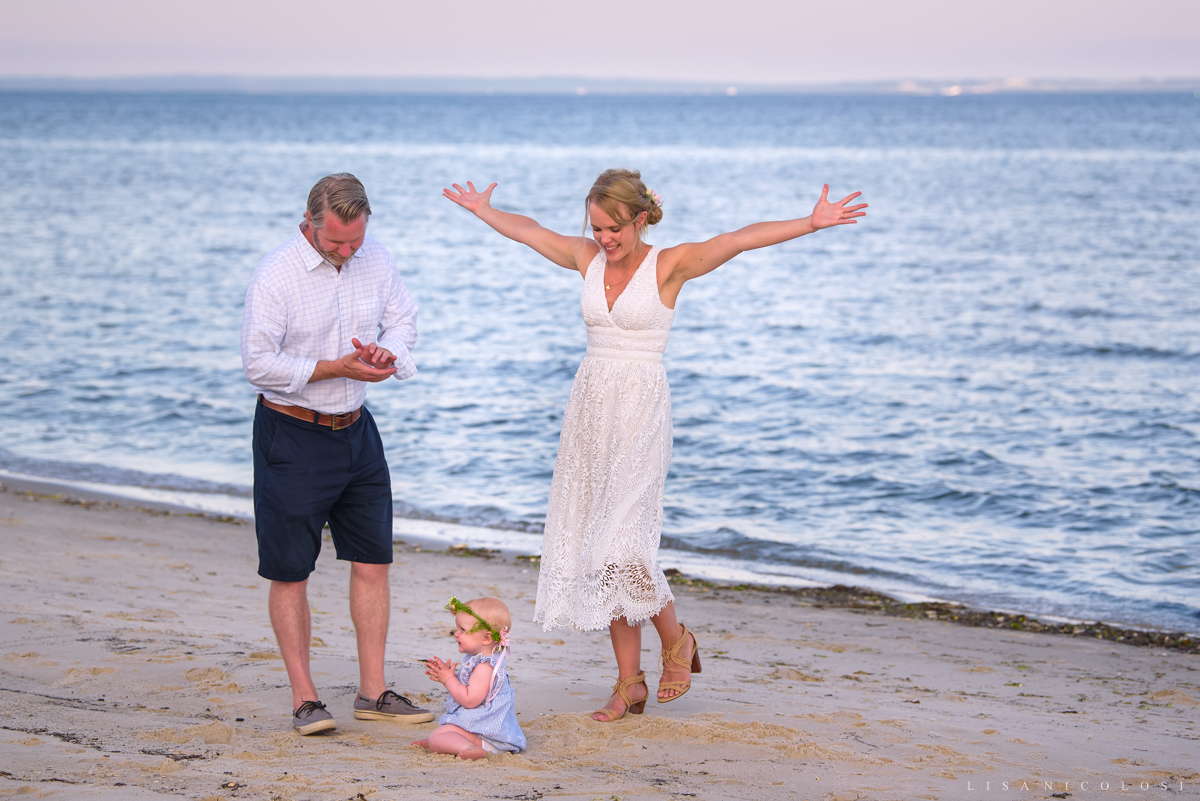Intimate North Fork backyard wedding ceremony on beach in Jamesport - bride and groom celebrating