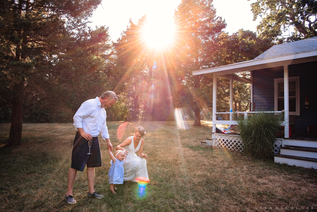 Intimate North Fork Wedding in Jamesport - Backyard wedding - bride and groom walking with baby