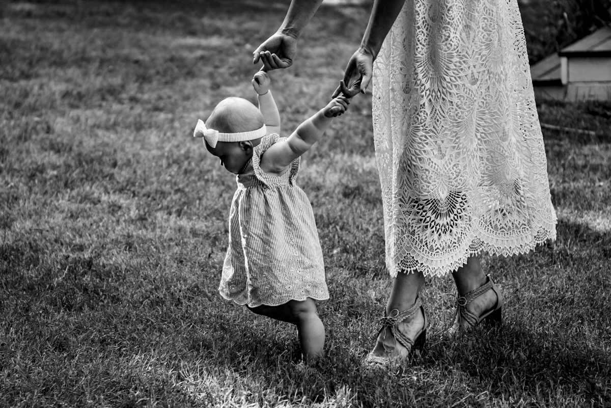 bride and baby walking - micro wedding in Jamesport NY