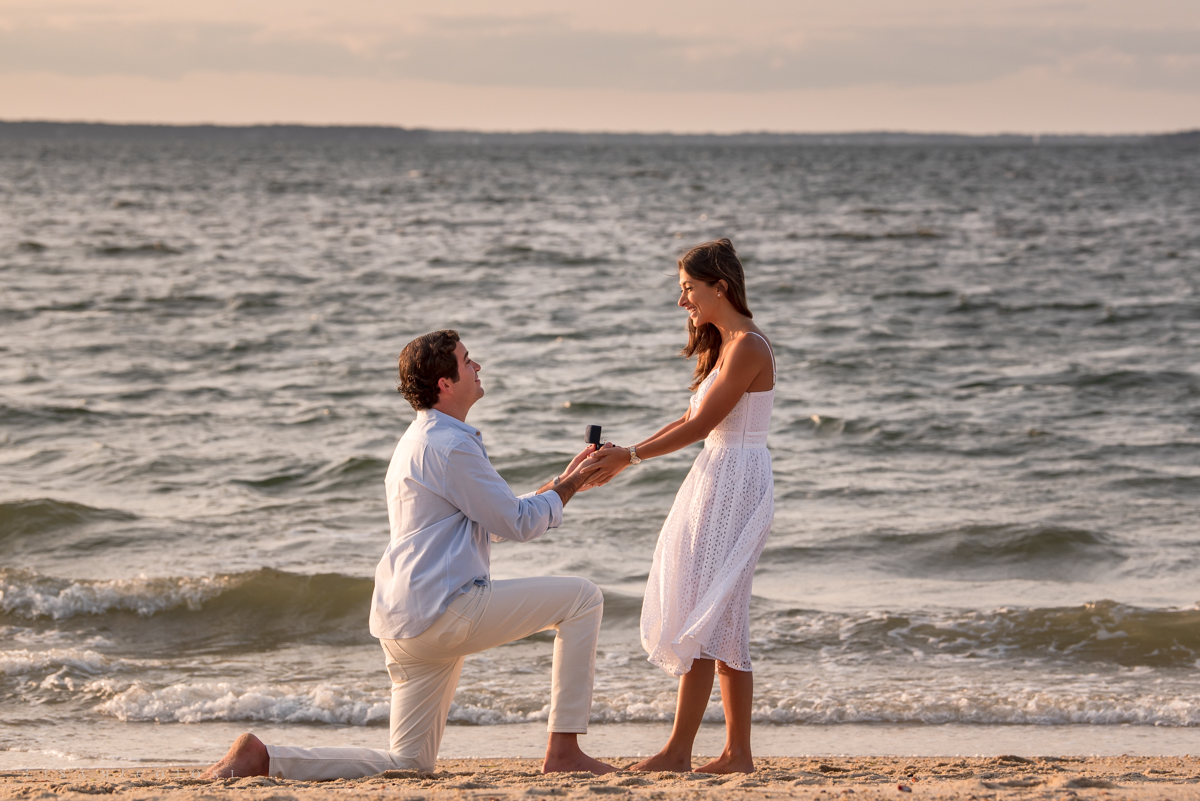 """Groom proposes marriage at Foster Memorial Beach while airplane flies a """"Marry Me"""" sign overhead"""