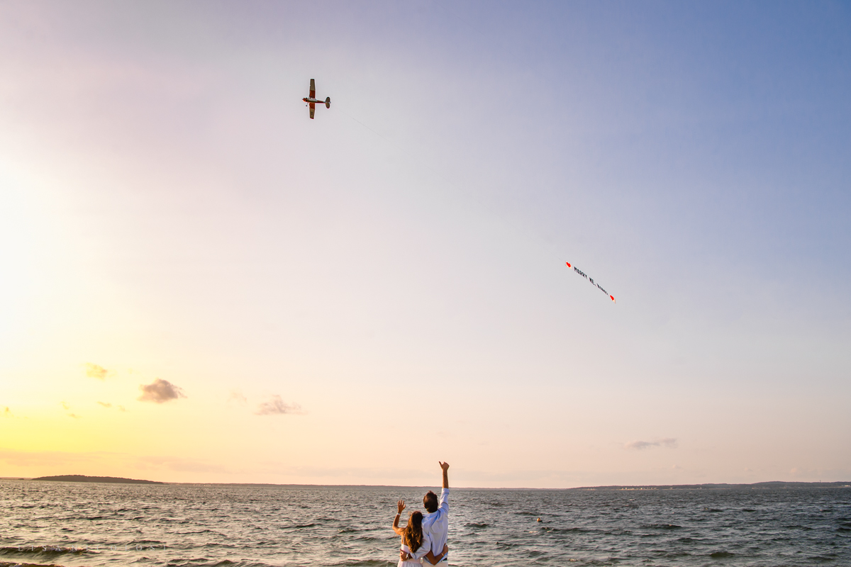 Couple waving to airplane in Sag Harbor