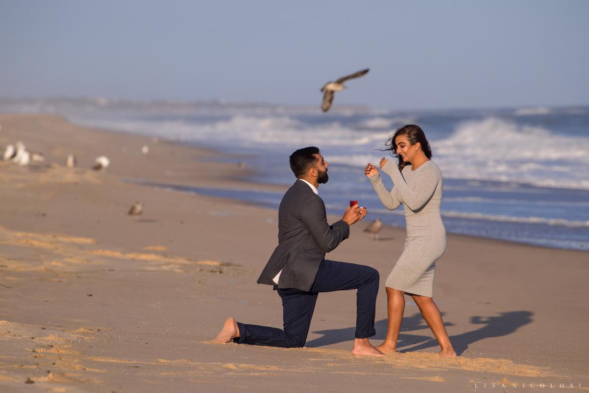 Surprise Montauk Marriage Proposal at Gurney's Resort - Groom kneeling on the beach - Engagement