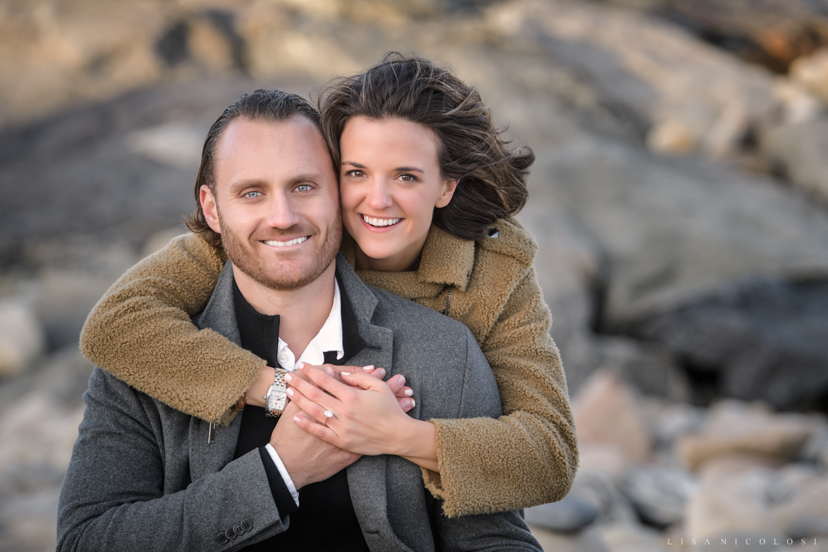 Classic portrait of bride and groom to be with engagement ring