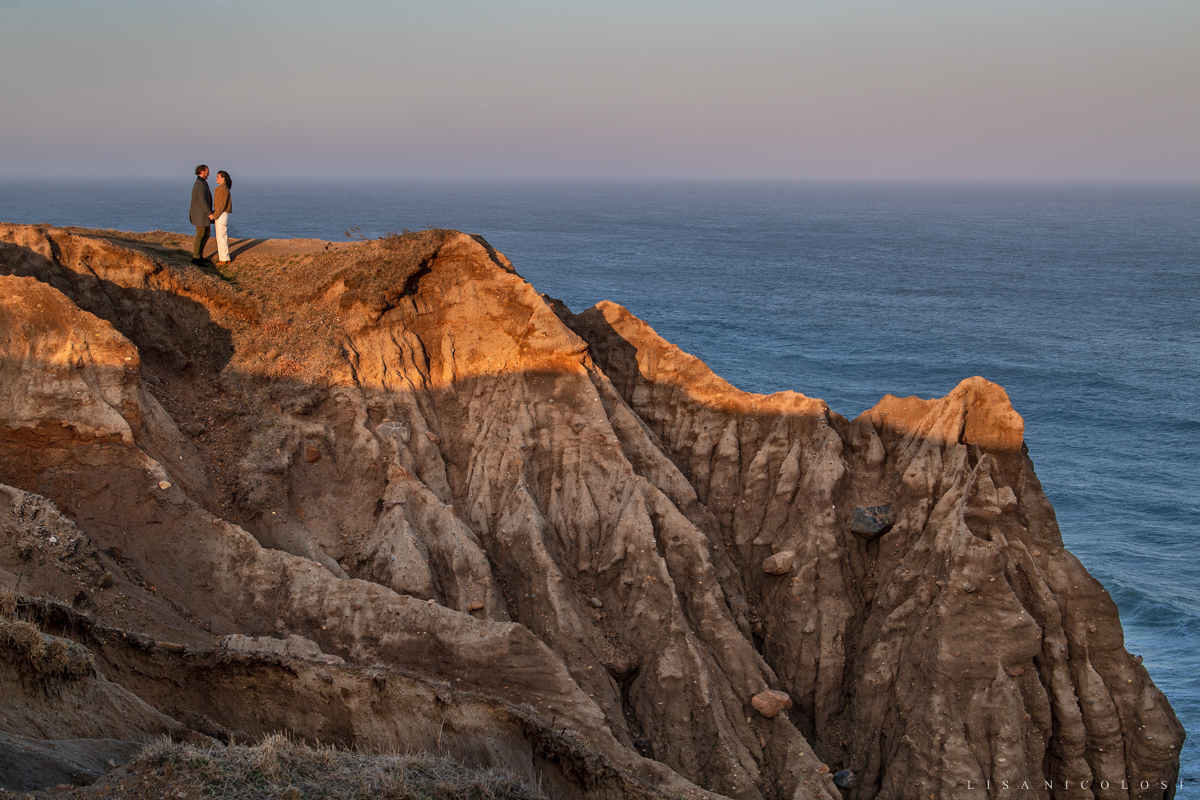 Adventurous engagement photo of bride and groom to be on the bluffs in Montauk before sunset.