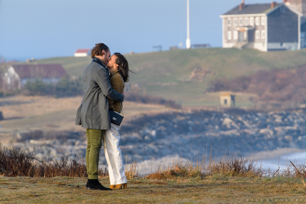 Couple kissing during surprise marriage proposal in Montauk