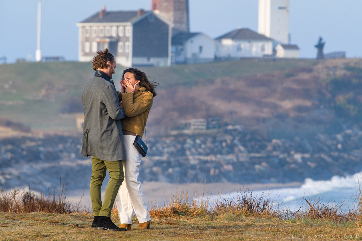 Candid photo of surprise proposal on the bluffs in Montauk - Bride crying happy tears.